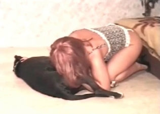 Redhead zoophile is taking a huge dick of a dog in her mouth