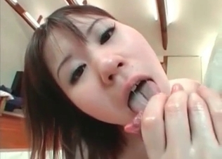 Asian slut is blowing dog dick